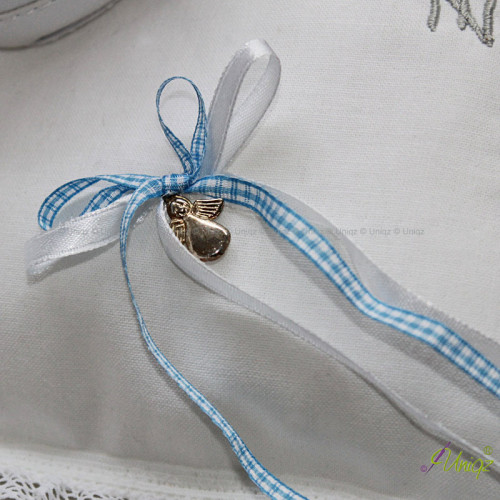 Detail: Doppelschleife mit Schutzengel