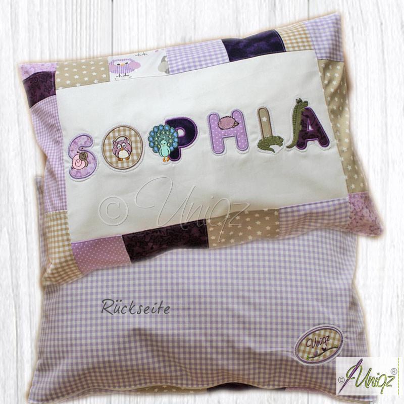 Kinderkissen mit Tier-Buchstaben in flieder, lila und beige