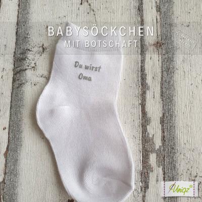 Schwanger? Babysöckchen mit Botschaft
